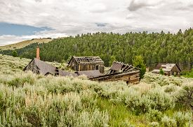 stock photo of outhouse  - Part of a once thriving mining town these buildings  - JPG