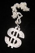 stock photo of gangster necklace  - Silver dollar - JPG
