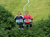 Two Girls On A Chair-lift In Summer poster