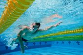 Underwater Photo of Athletic Male Swimmer doing Laps in a Pool