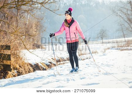 Poster: Woman doing cross country skiing