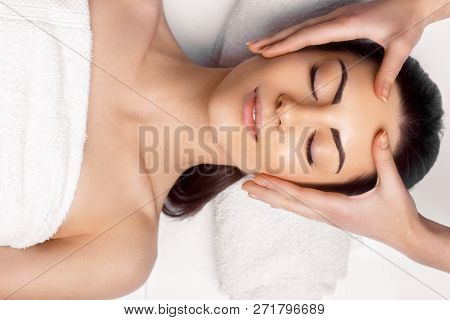 poster of Face Massage.  Close-up Of Young Woman Getting Spa Massage Treatment At Beauty Spa Salon.spa Skin An