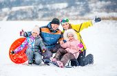 Active happy family smiling and laughing while playing outdoors during winter holidays. Winter fun o poster