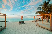 White Beach Canopies At Sunset. Luxury Beach Tents At Luxurious Beach Resort. Summer Beach Concept,  poster