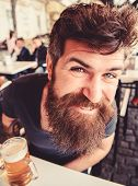 Guy Having Rest With Cold Draught Beer. Hipster On Happy Face Drinking Beer Outdoor. Man With Beard  poster