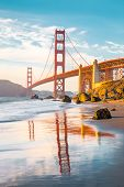 Classic Panoramic View Of Famous Golden Gate Bridge Seen From Scenic Baker Beach In Beautiful Golden poster