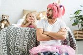 Adorable Happy Daughter Looking At Smiling Father In Pink Wig And Tutu Skirt poster