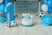 Festive Background Decoration For Birthday With Cake, Letters Saying One And Blue Balloons In Studio poster