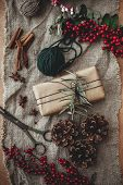 Merry Christmas Concept, Atmospheric Flat Lay. Stylish Rustic Gift Box With Green Branch And Fir Bra poster