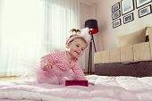 Beautiful Little Baby Girl Wearing Pink Tutu Skirt, Crawling On The Living Room Floor, Reaching For  poster