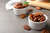 Small Dish With Tasty Pecan Nuts Served On Table. Space For Text poster
