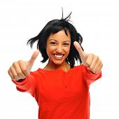 stock photo of windswept  - Happy attractive girl with two thumbs up and windswept hair - JPG