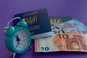 Travel Concept: Alarm Clock, International Passport And Euro Banknotes On A Purple Background. Low C poster