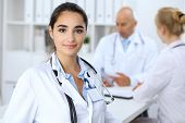 Portrait Of Young Doctor Woman  In Hospital. Hispanic Or Latin American Staff In Medicine poster