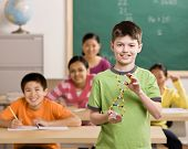 image of students classroom  - Student holding molecular model in science classroom - JPG