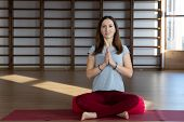 Young Woman In The Lotus Position While Meditating poster