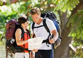 image of tramp  - Couple with backpacks looking at map - JPG