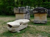 pic of hearse  - Old sarcophagi exposed in City Park in the city of Jajce Bosnia - JPG