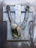 foto of crucifiction  - A gray metal statue of crucified Jesus Christ - JPG
