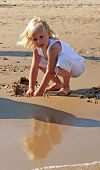 Girl Building A Sand Castle poster