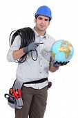 stock photo of hookup  - Electrician wiring the world - JPG