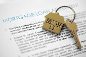 stock photo of deed  - Mortgage loan agreement application with house shaped keyring - JPG