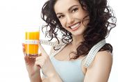 stock photo of cold-shoulder  - head and shoulders portrait of attractive  caucasian smiling woman isolated on white studio shot drinking orange juice face skin - JPG