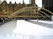 Ice Resurfacing machine smoothing ice in skating rink poster