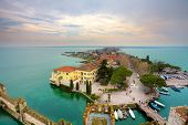 Aerial view from Scaglieri castle on Lake Garda and town of Sirmione in Italy.
