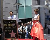 LOS ANGELES - JUN 20:  Benny Medina, Jennifer Lopez at the Hollywood Walk of Fame star ceremony for