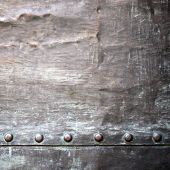 foto of stelles  - Black grunge metal plate or armour texture with rivets as background
