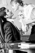 picture of office romance  - businesswoman is seducing her boss at office - JPG