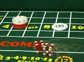 stock photo of crap  - dice rolling on craps table - JPG