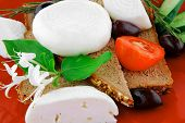 italian mozzarella and vegetables on red plate