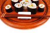 Japanese Cuisine : Sushi Maki Roll with Salmon and tuna inside . on wooden plate with wasabi and gin