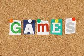 stock photo of arcade  - The word Games in cut out magazine letters pinned to a cork notice board - JPG