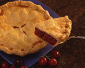 stock photo of cherry pie  - Cherry Pie on Blue Plate with Brown Granite Background - JPG