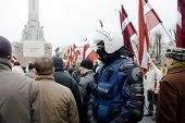 Riot Policeman In Crowd