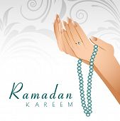 stock photo of namaz  - Ramadan Kareem background with female human hands holding rosary and praying - JPG