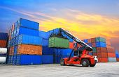 stock photo of truck  - forklift handling the container box at dockyard with beautiful sky - JPG