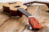 stock photo of ukulele  - two ukulele  guitar on wooden background  studio shot - JPG