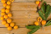 stock photo of loquat  - Still life with some freshly picked loquats - JPG