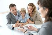 stock photo of contract  - Family signing home purchase contract on tablet - JPG
