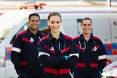 foto of ambulance  - group of emergency medical technicians in front of ambulance - JPG