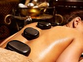 stock photo of ayurveda  - Young woman having Ayurveda stone massage - JPG