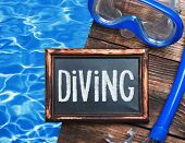 image of rubber mask  - blackboard with the words diving and swim mask and snorkel on a background of water - JPG