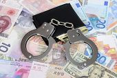 picture of shekel  - Currency from world with handcuffs and wallet - JPG