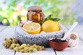 image of home remedy  - Folk remedies for colds on table on natural background - JPG