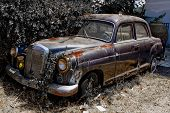foto of neglect  - Rusted old car neglected for several years - JPG