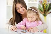 pic of jigsaw  - Mother and daughter playing at home - JPG